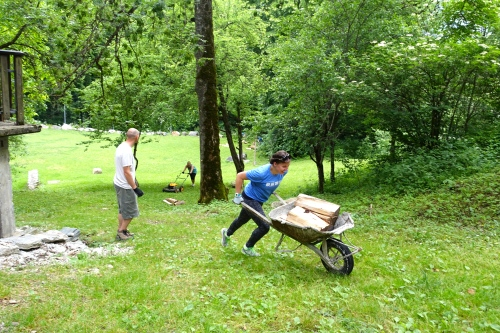 Shannon racing uphill with the wheelbarrel