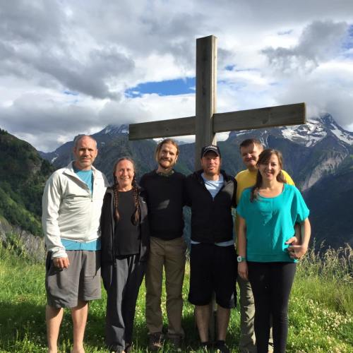 Team under the cross in French Alps