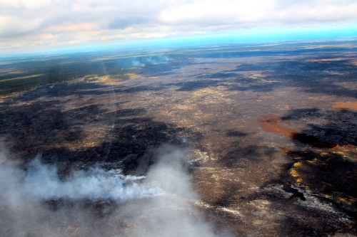 Fires burning at edges of lava flow