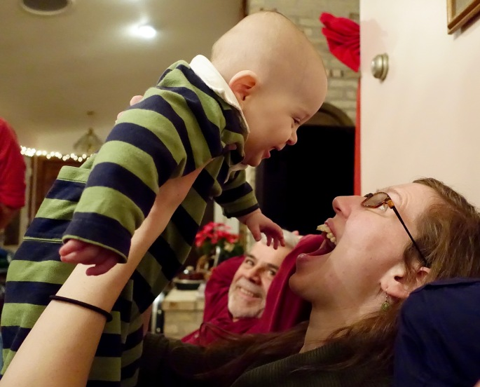 Happy Baby playing with Mom