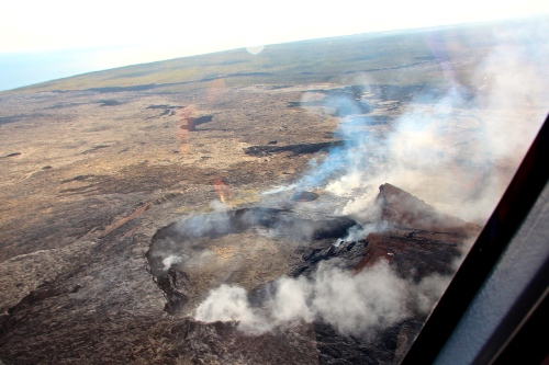 Helicopter approaching lava lake Mt. Kilauea