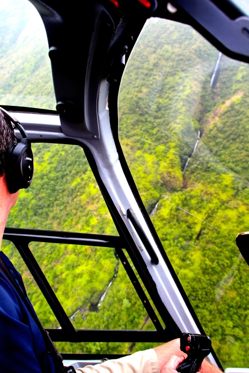 Helicopter Pilot above Waterfalls in Hawaii