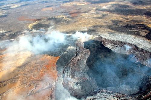 Lava Flow reaching top of caldron. Mt. Kilauea