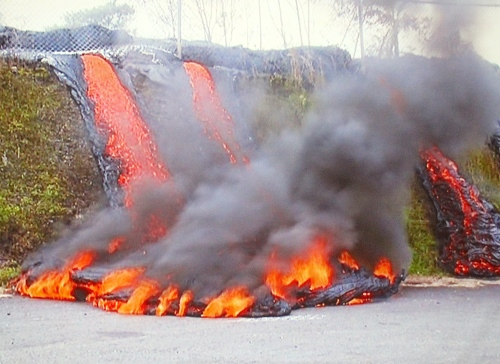 Lava flowing onto highway in Hawaii