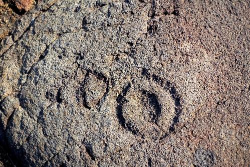 Symbols etched in stone Petroglyph field near Waikoloa