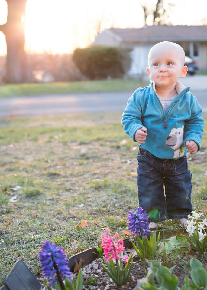 Baby in the garden standing by himself