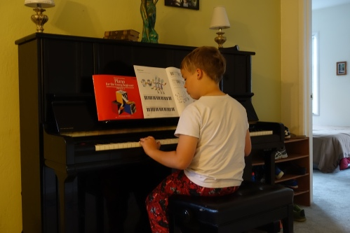 Child practicing piano