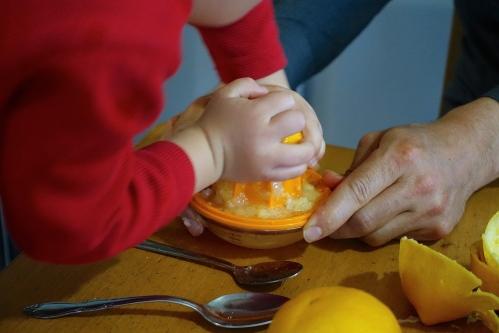 Little boy squeezing lemons