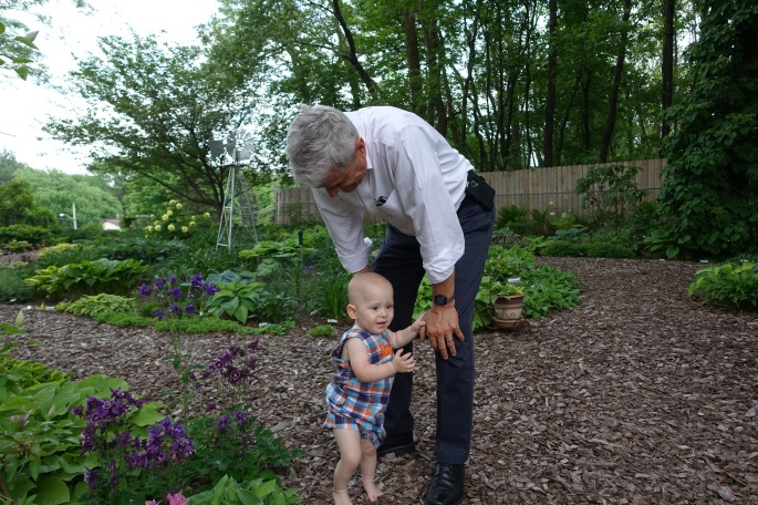 Alan with Samuel in Hosta Garden