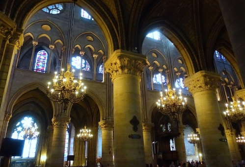 Beautiful lighting inside Notre Dame Cathedral. Paris