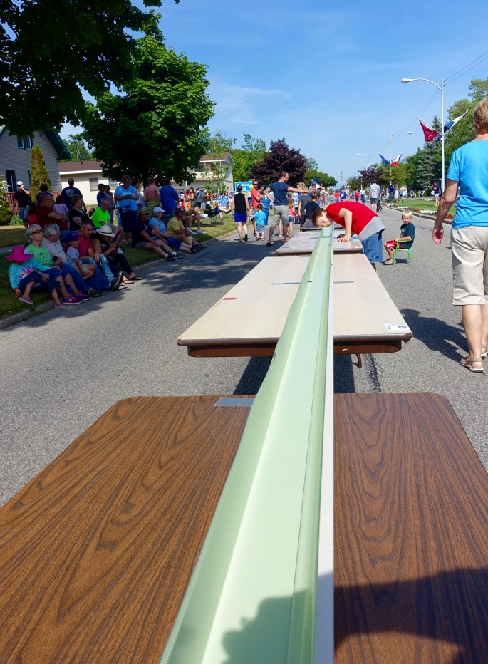 Boy checking gutter at Ludington's World's Largest Sundae Attempt