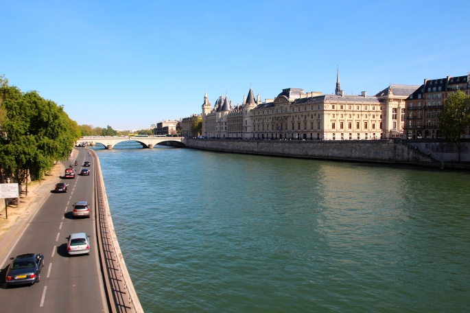 Cars driving along The Seine River
