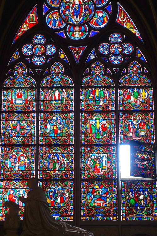 Door of hope opens in stained glass window Notre Dame Cathedral. Paris