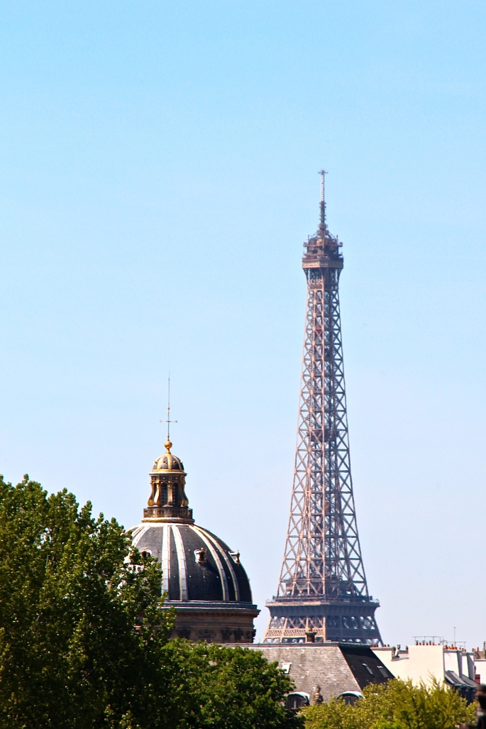 Eiffel Tower Towers over Churches