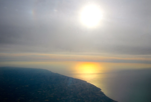 Flying Across English Channel to France at Sunset