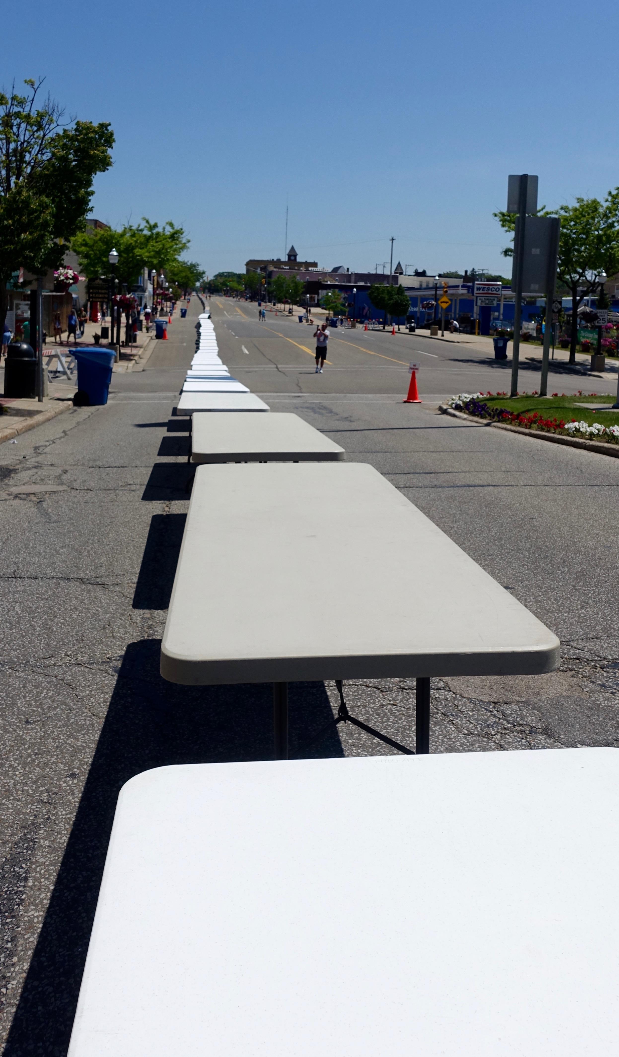 Hundreds of tables line Ludington Ave. at Ludington's World's Largest Sundae Attempt