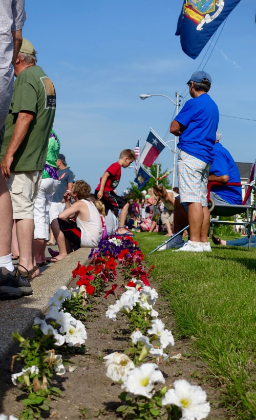 Little boy stepping over petunias Kathi eating sundae at Ludington's World's Largest Sundae Attempt