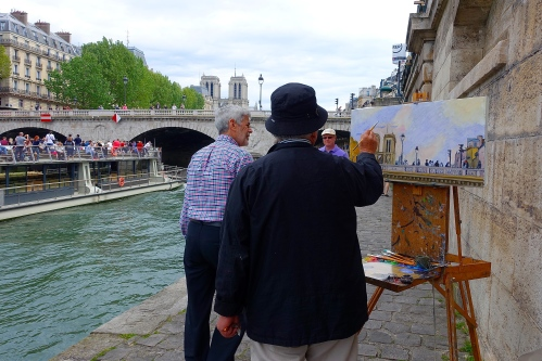 Painter painting The Seine River