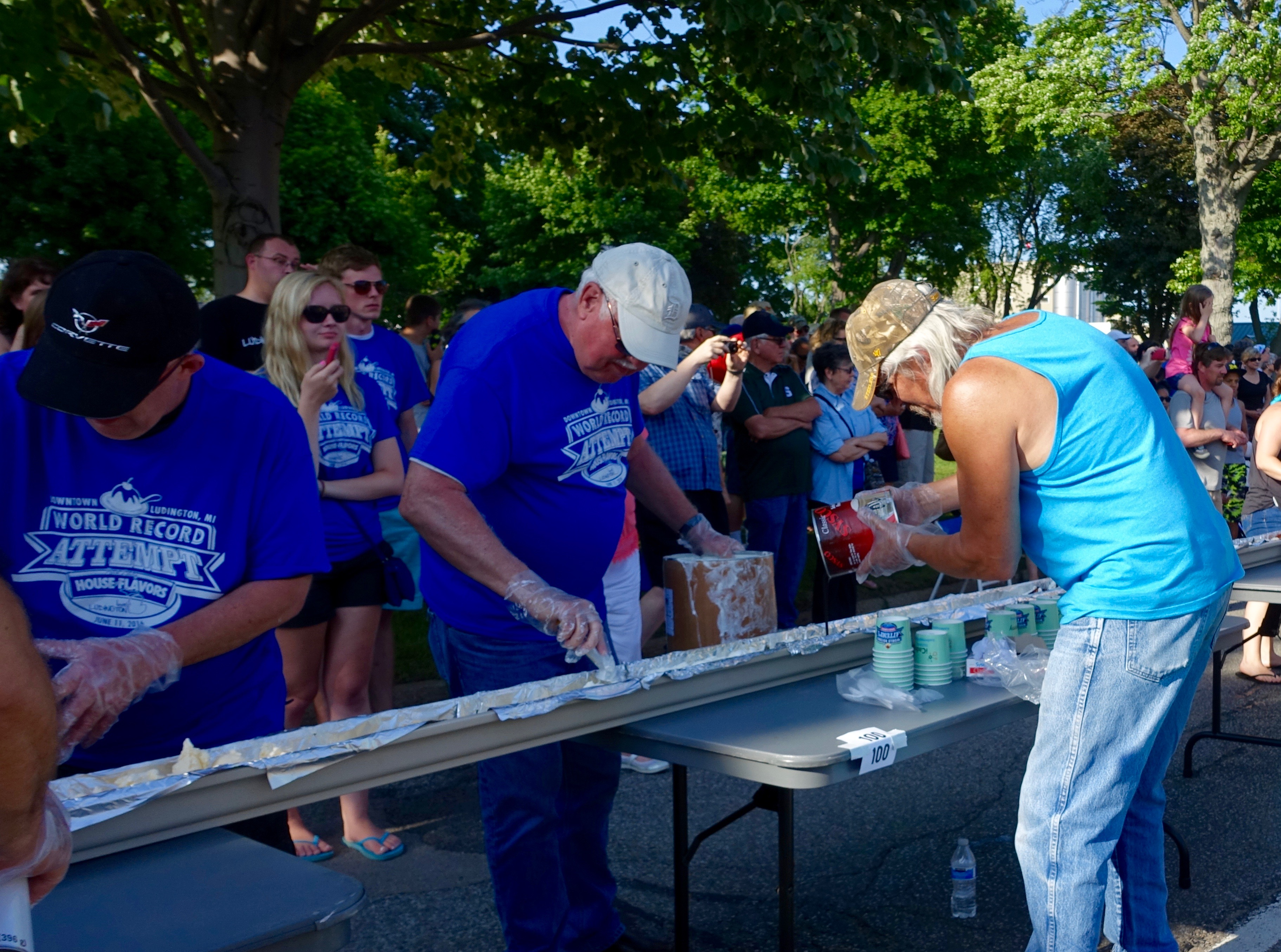 Pouring Chocolate Syrup at Ludington's World's Largest Sundae Attempt