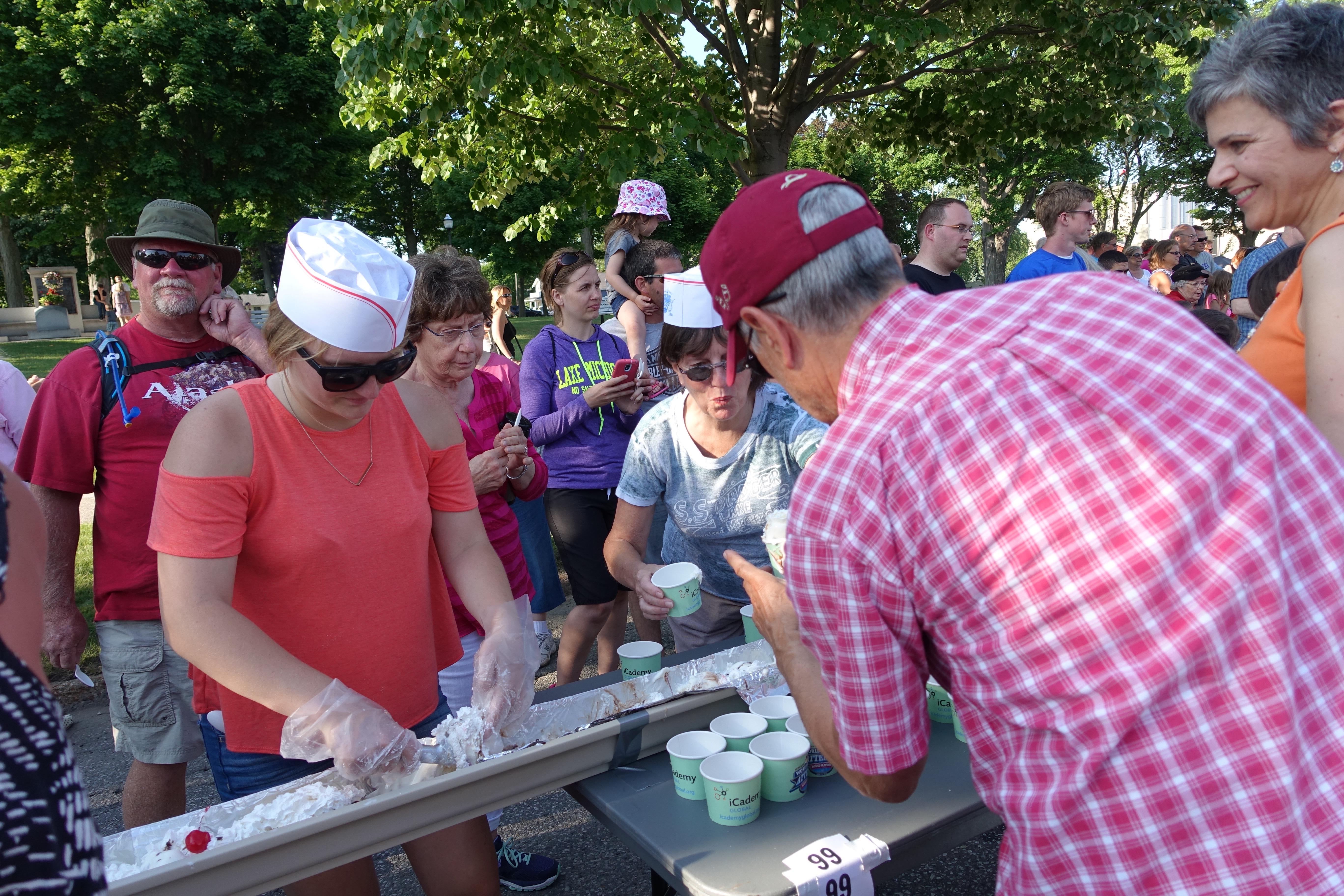 Receiving sundae Kathi eating sundae at Ludington's World's Largest Sundae Attempt