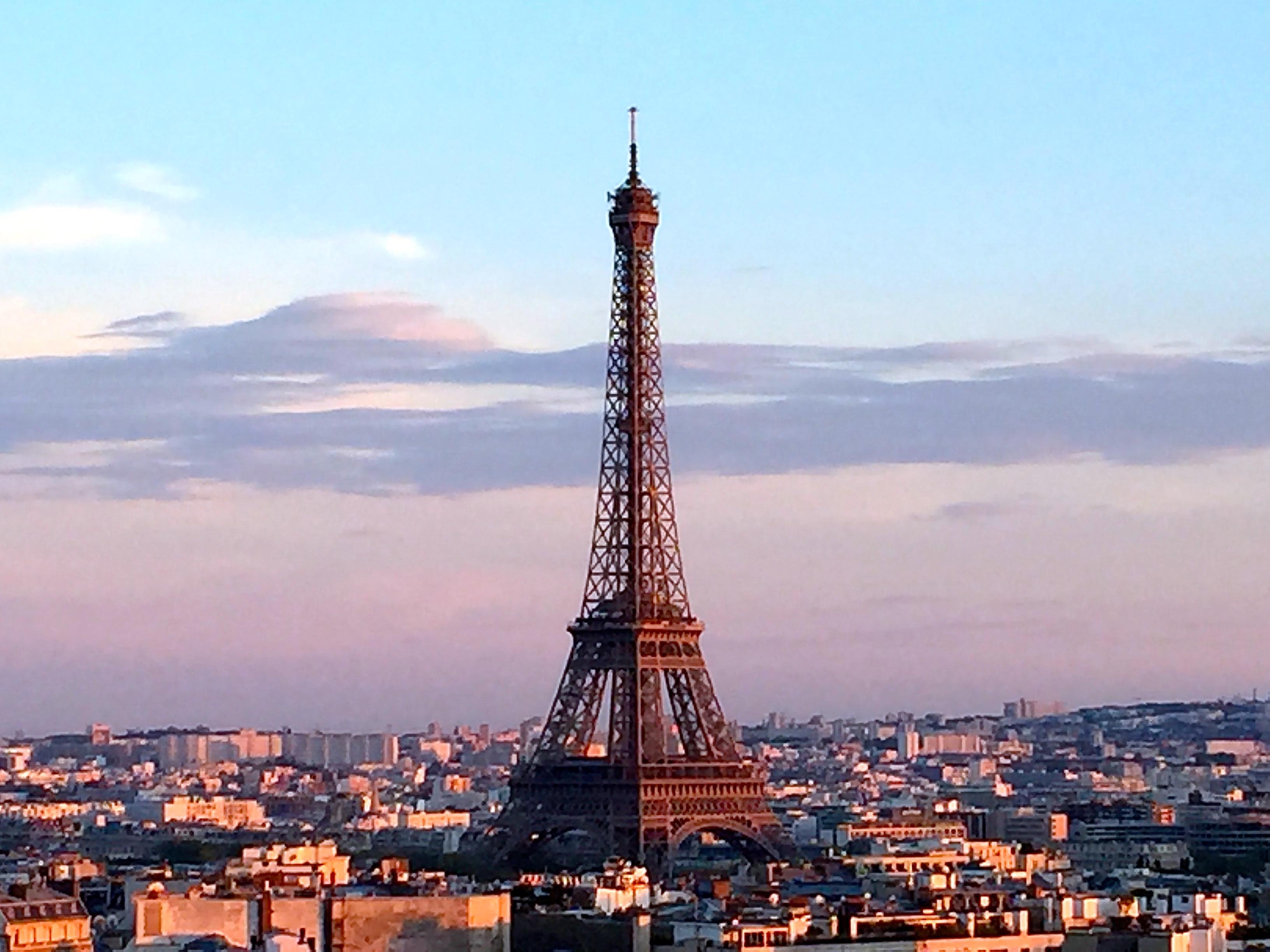 Sun setting behind Eiffel Tower