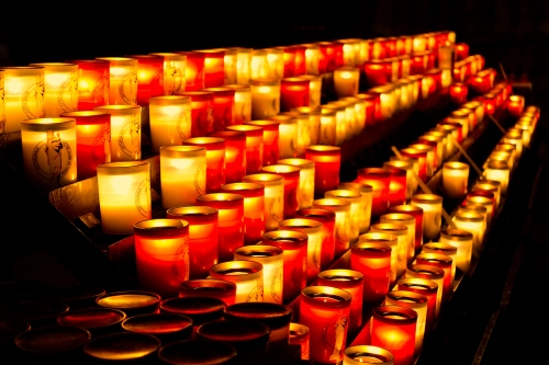Votive candles burning in Notre Dame. Paris, France