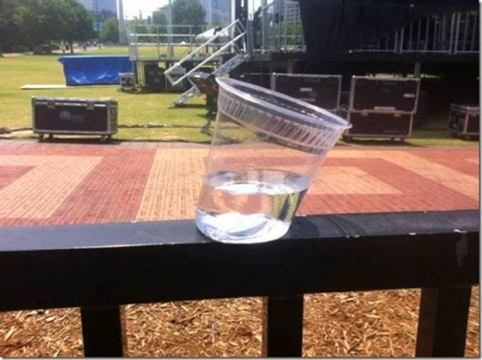 Plastic cup melter on railing