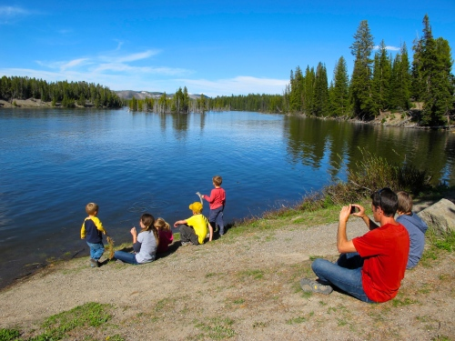 Children playing on shore of lake in Grand Tetons