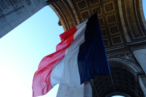 french-flag-flying-at-arc-de-triomphe