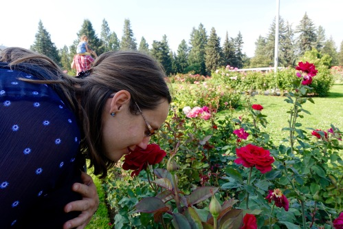 Lady smelling roses