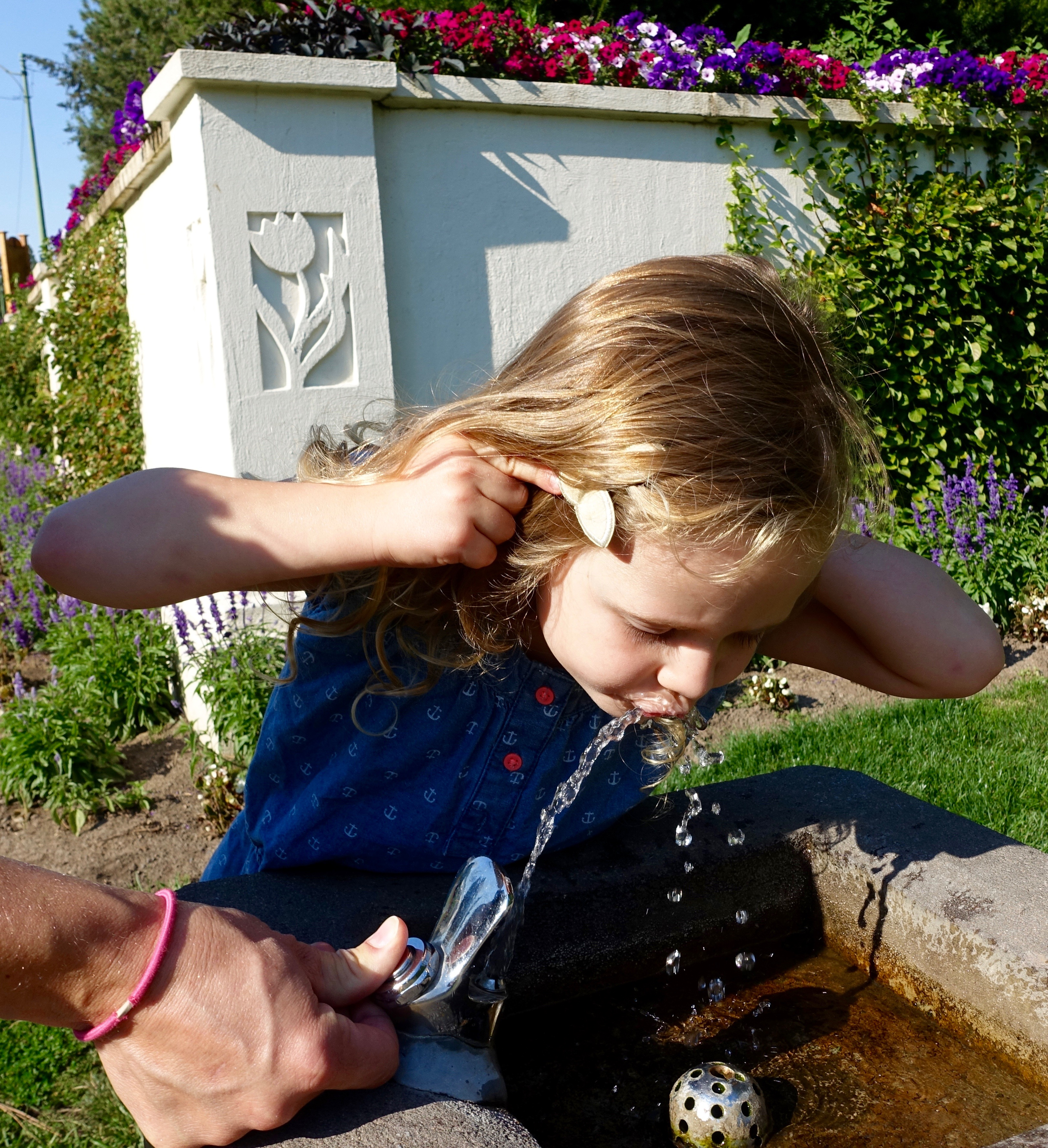 Little girl at drinking fountain