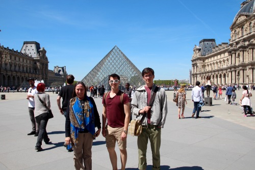 standing-in-front-of-the-louvre-museum-paris