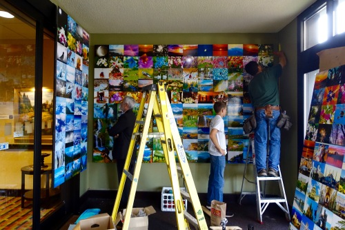 artzprize-8-kathryn-w-armstrongs-mural-being-installed-at-the-holiday-inn
