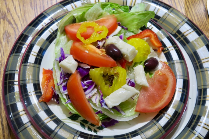wedge-salad-with-brie-peppers-tomatoes-greek-olives-pepper-rings