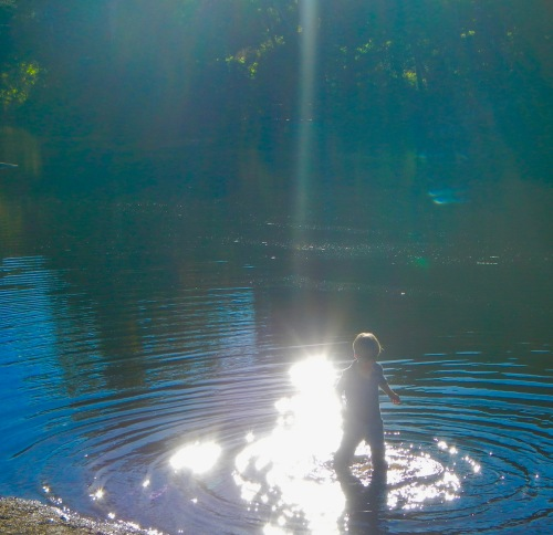 boy-playing-in-water-in-sunshine