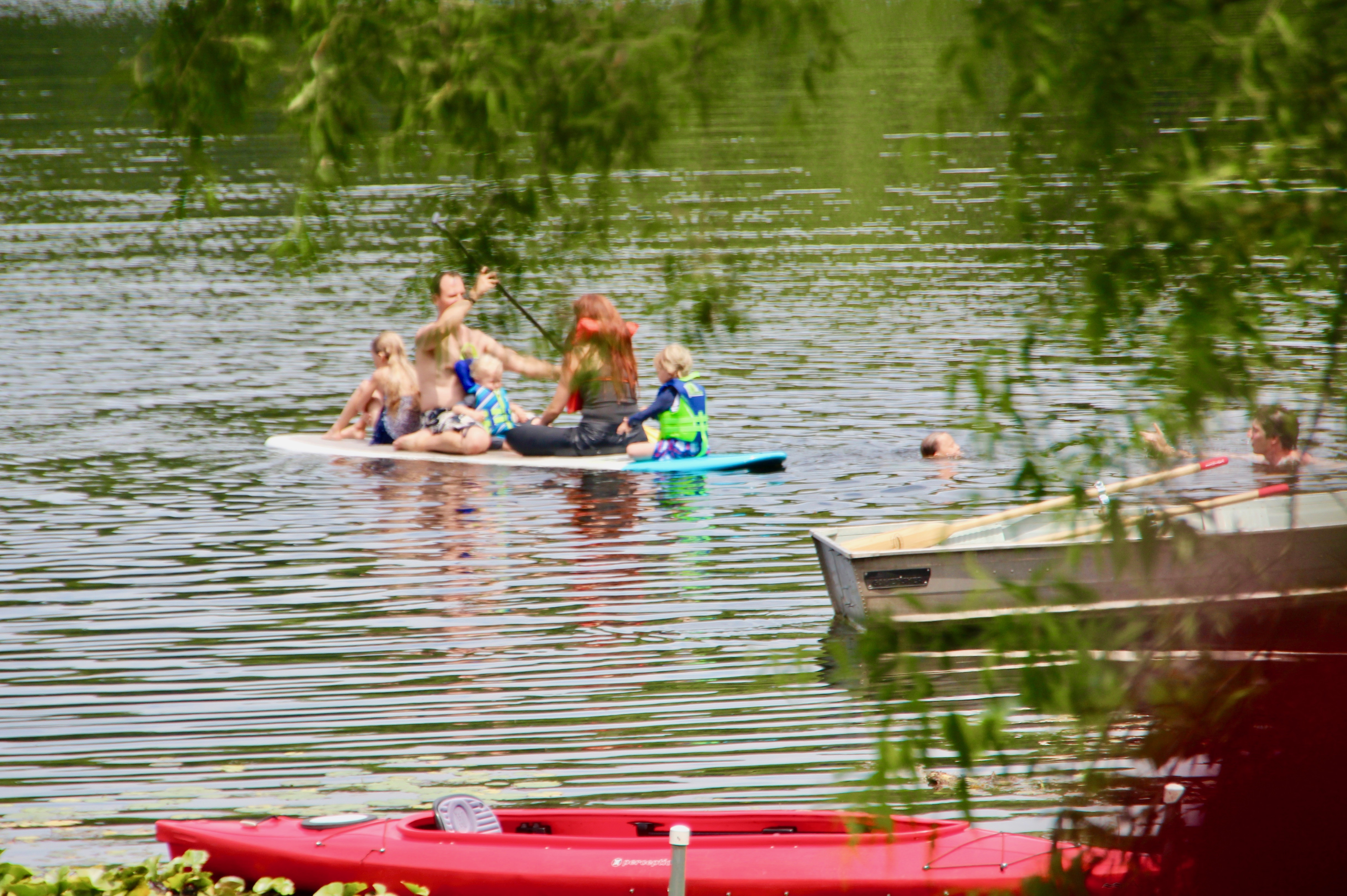 family-playing-of-stand-up-paddleboard-sup