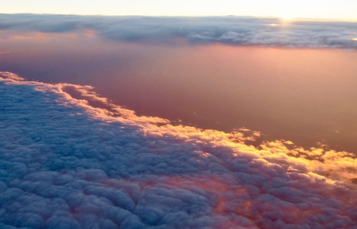 pastel-sunrise-over-clouds