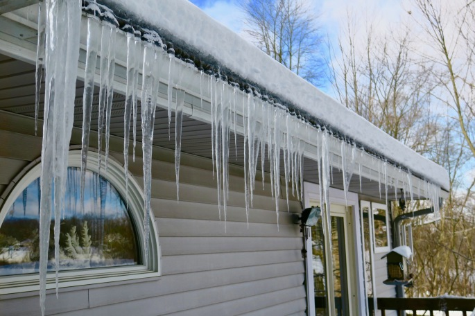 row-of-icicles-hanging-off-roof