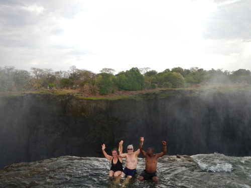 siting-on-the-top-of-the-devils-pool-zambia-victoria-falls