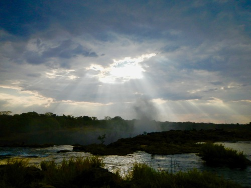sunset-over-the-zambezi-river-with-steam-from-victoria-falls
