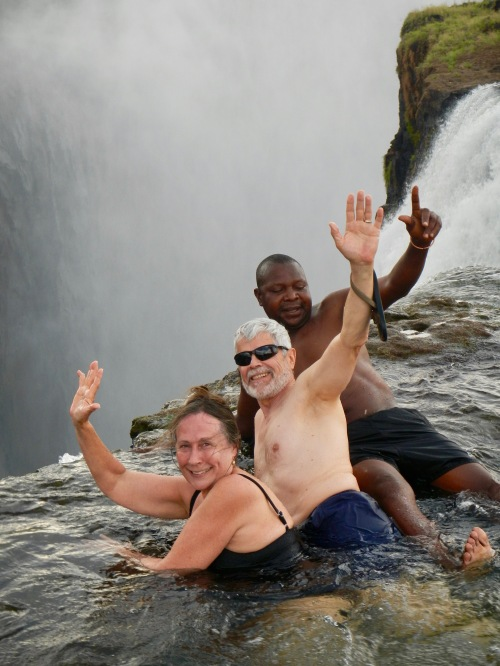 waving-from-the-top-of-victoria-falls-at-the-edge-of-the-devils-pool