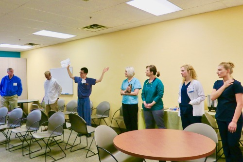dental-director-explaining-free-dental-day-to-volunteers-exalta-grand-rapids-mi