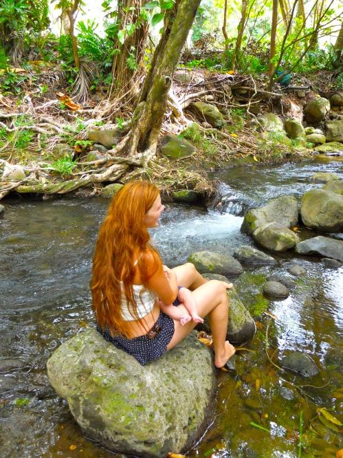 playing-near-little-waterfall-in-kauai