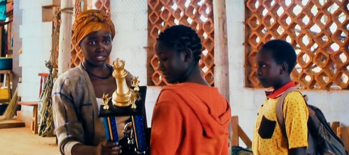 receiving-prize-in-queen-of-katwe