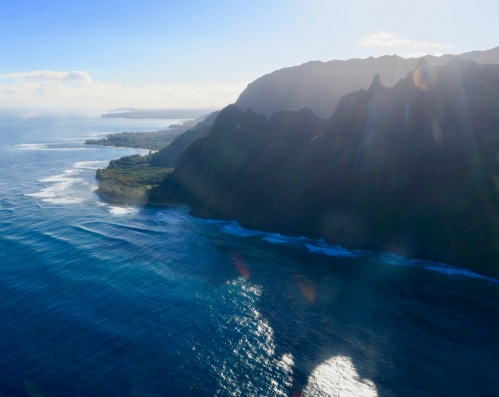 sun-streaming-between-mountains-on-na-pali-coast-kauai