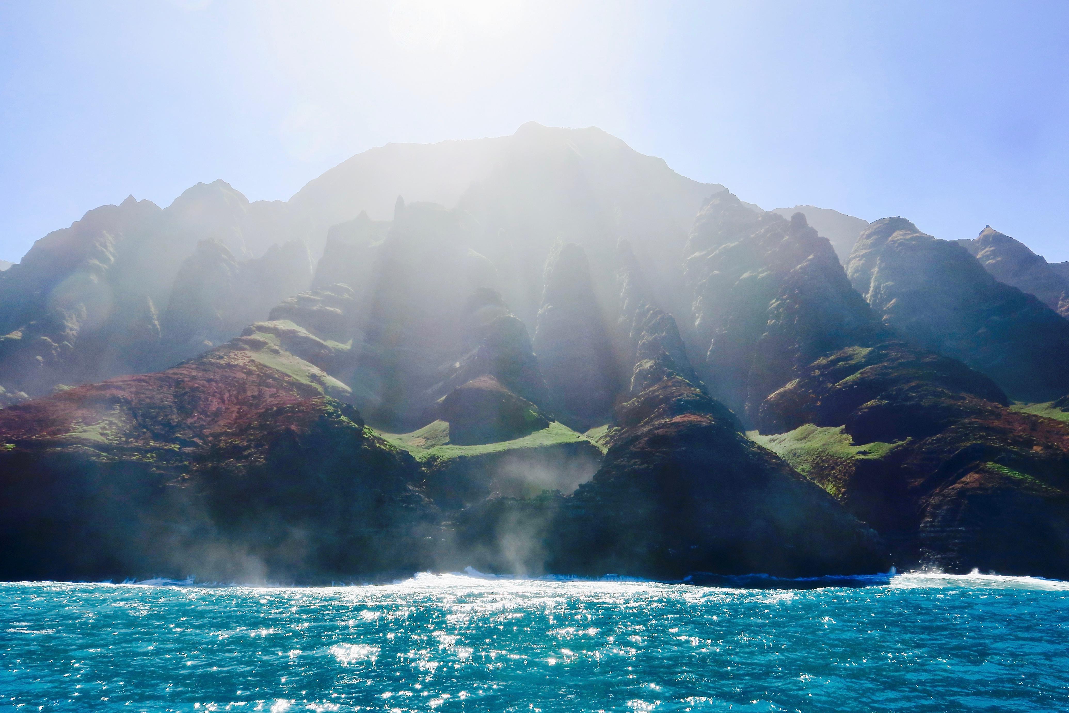 sun-streaming-down-on-na-palis-rugged-coast-kauai