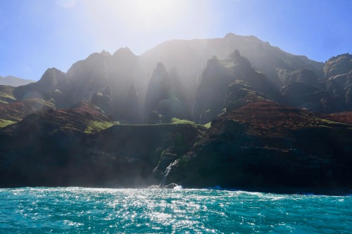 sunshine-and-waterfall-along-kauais-na-pali-coast