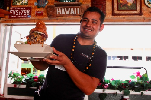 waiter-with-triple-cheeseburger-in-paradis-maui